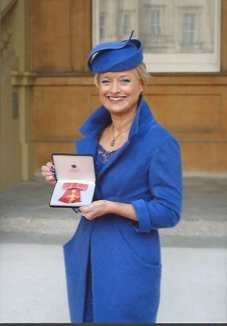 Joyce Young OBE outside Buckingham Palace with her OBE presented by Prince Charles for Services to Textiles